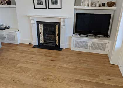 The oak wood flooring in the living room