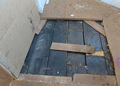 We had to remove the chipboard in sections to repair the original floorboards