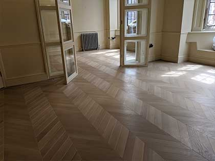Open french doors showcase the oak chevron floor in the reception rooms #CraftedForLife