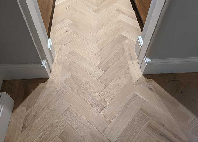 The single row parquet borders are mitred at each corner #CraftedForLife