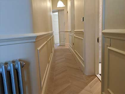 The narrow hallway does not have a border to retain the chevron pattern #CraftedForLife