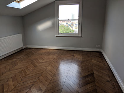 This darker chevron floor does, so each block is more clearly defined