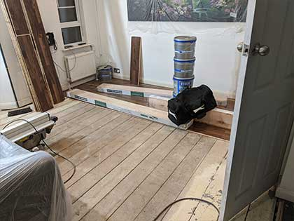 The new floor was fitted on top of the original pine floor