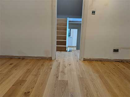 The wood flooring was fitted on the different floors and linked by the stairs which were also clad in oak