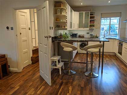 The new engineered walnut flooring in the kitchen