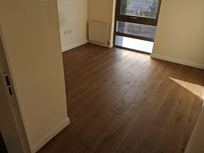 A deep sand would be required to remove the bevel on this floor