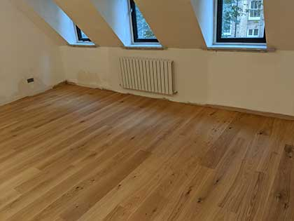 The natural grade flooring features more knots and colour variation