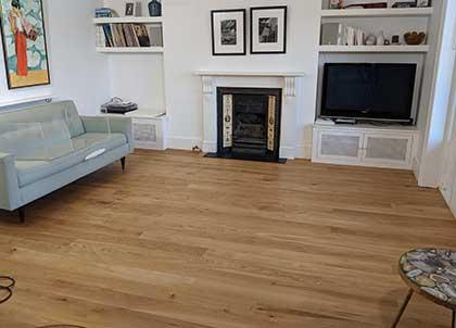 The newly installed engineered hardwood oak floor