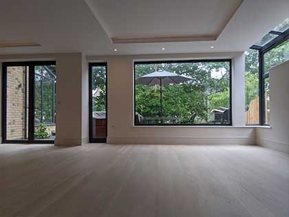 The new oak floor opens up the large living room area #CraftedForLife