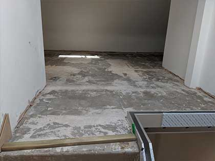 The concrete was ground down to create a smooth subfloor