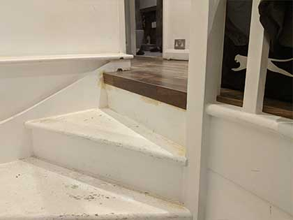 A piece of nosing was attached to the riser on the top step