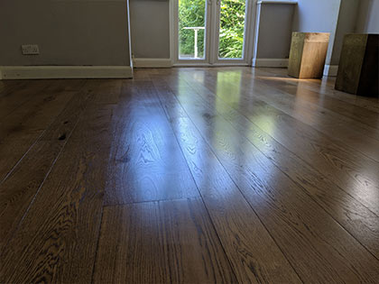This wooden floor runs in the direction of the window