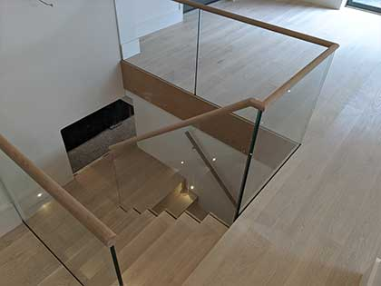 The wooden handrail is a great contrast to the sleek glass balustrade #CraftedForLife