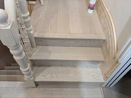 We developed another special technique to fit the boards under the spindles so that it looked like the new floor had been there since the stairs were built originally #CraftedForLife