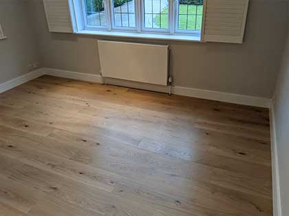The boards in the living room run parallel to the windows rather than towards, as we would normally recommend, due to the way the room would be used #CraftedForLife