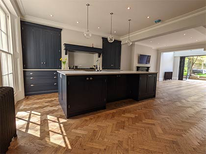 The new rear extension showcases a traditional herringbone parquet with a double row border #CraftedForLife