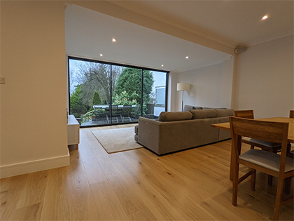 We installed wide engineered oak boards (210mm) of various lengths in the expansive open plan kitchen and living space #CraftedForLife