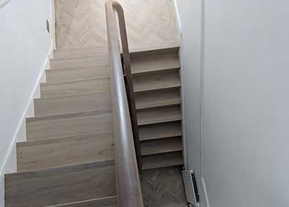 Achieving a straight border between the flights of stairs took time and skill