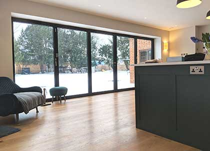 Precision cutting ensured the wood flooring runs neatly up to the bi-fold doors