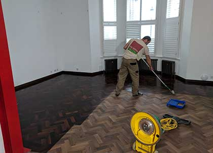 Oiling the parquet wooden floor