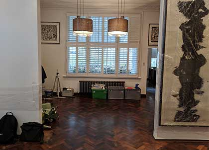The original herringbone parquet wood floor was looking tired and dull