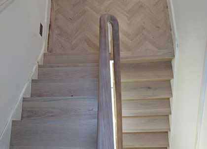 The landing, stairs and sanded handrail