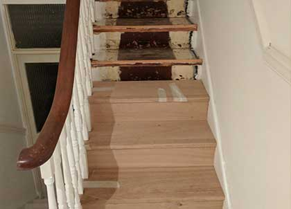 The old stairs and the new oak cladding