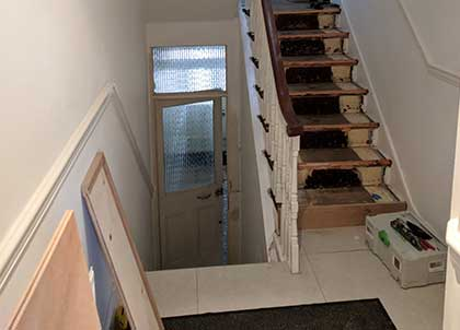 The stairs and part of the landing before our work began