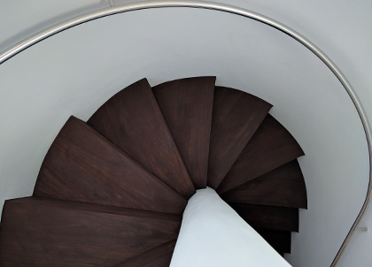 We crafted each piece of wood to create this spiral staircase