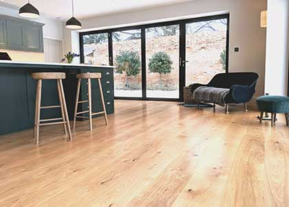 The news wide oak flooring bring warmth and character to the shaker style kitchen