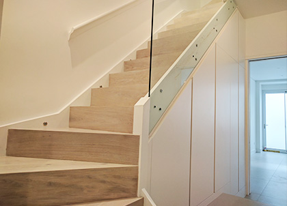 A modern staircase with a straight tread and riser with seamless join