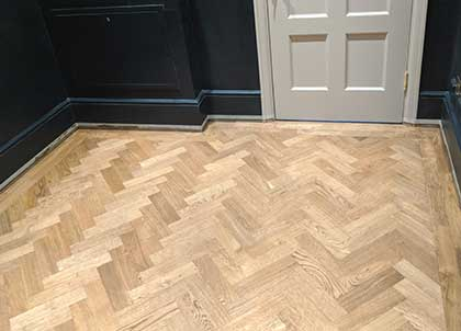 The new oak parquet floor in the cloakroom