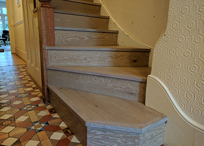 Classic stairs with nosing and shaped bottom step