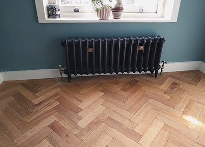 A stylish radiator looks good and can help prevent the wood flooring from overheating