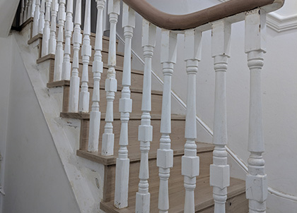 Stairs with an open cut stringer