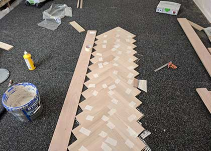 We laid the parquet in the middle of the room, working towards the walls