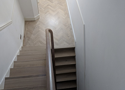 Oak stairs complement the oak parquet wood flooring in the hallway and landing