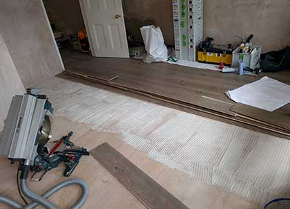 Engineered flooring being fixed into place